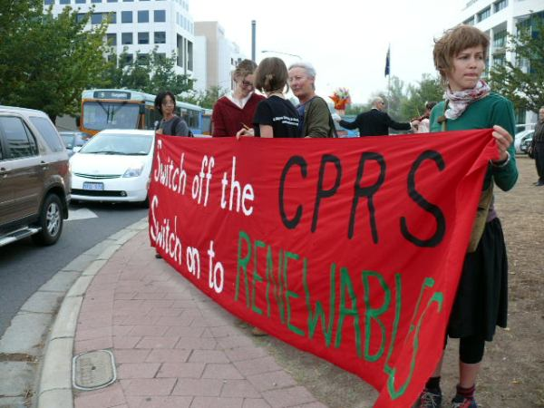 "Some of the crew with ""switch off the CPRS, switch on to renewables"" banner"